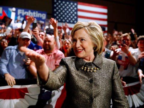 Clinton Unleashes Media Blitz In Battlegrounds