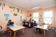 Burlington-Christian-School-Teacher-Giving-Christian-Student-Help