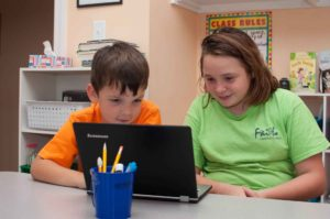 Private Christian Elementary School Students Between Burlington and Greensboro NC Looking at Computer