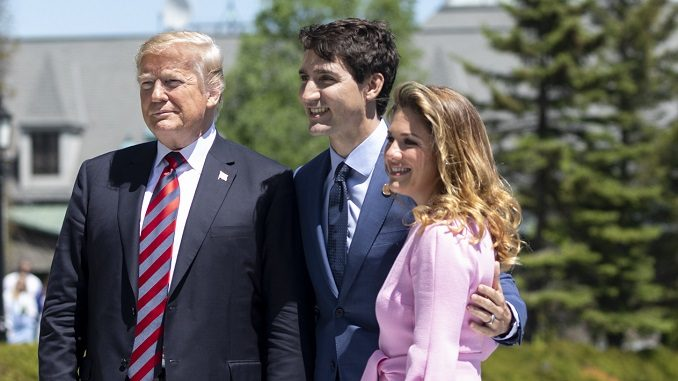 President Donald Trump is met by Justin and Sophie Trudeau at the G7 conference.
