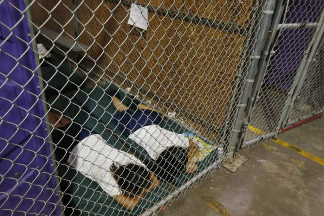 Children sleep in cages at the border. June 18, 2014