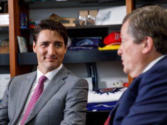 Prime Minister Justin Trudeau speaks to Toronto Mayor John Tory.