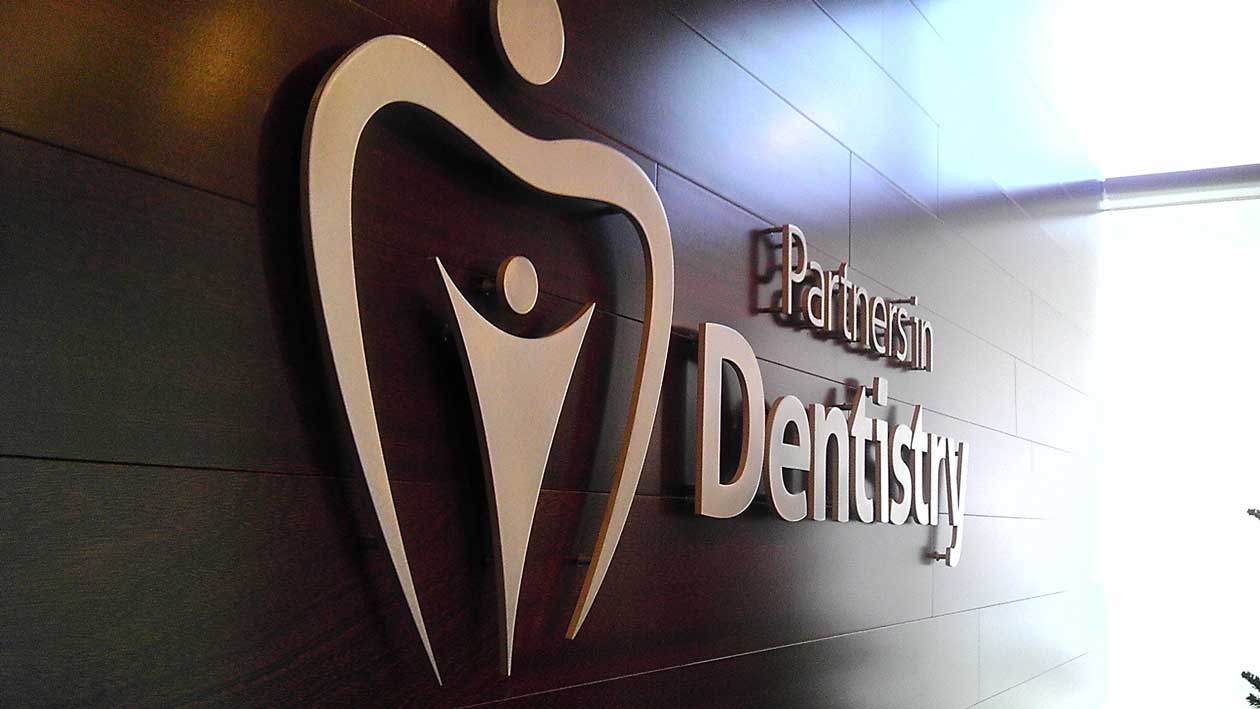business indoor sign partners in dentistry