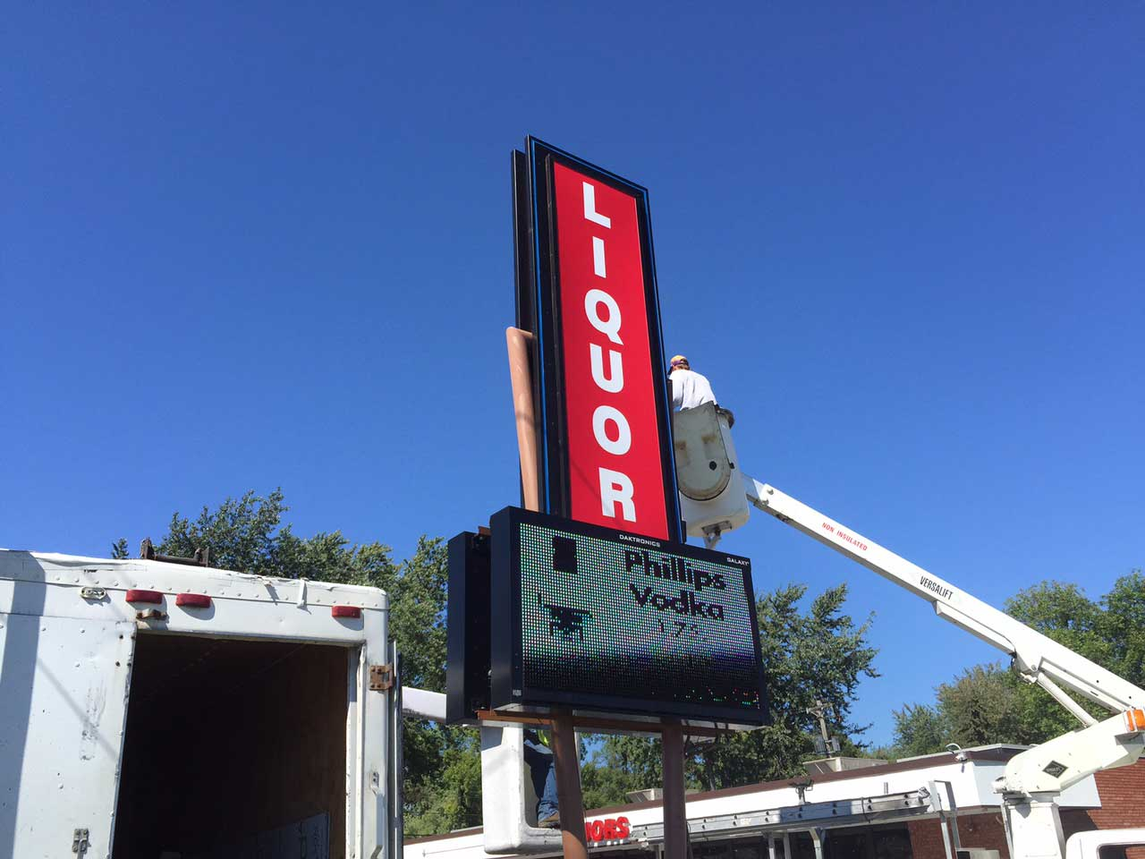 custom pylon sign liquor installation
