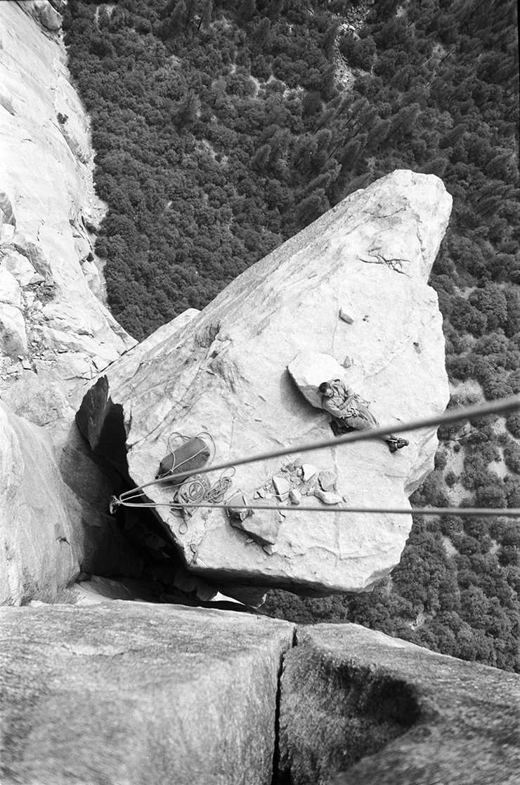 A climber relaxing on a ledge in Yosemite NP, California (High Angle Perspective, Historic Image).