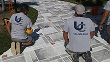 Universal Construction Workers laying a patio
