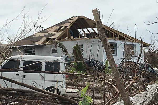 House and Car damaged by Hurricane Dorian
