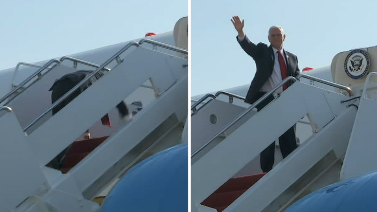 Pence falls while boarding Air Force 2, signals he is OK