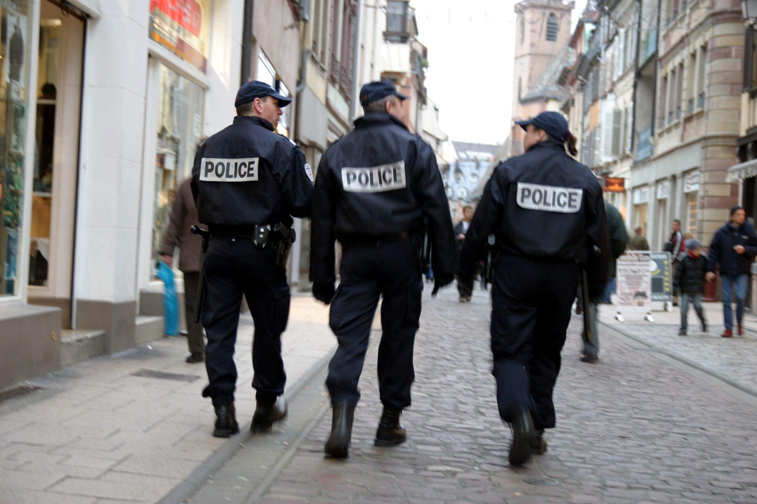 Police Officers Walking Down Street