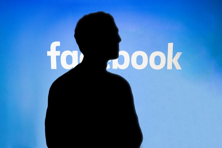 Shadow In Front Of Facebook Sign