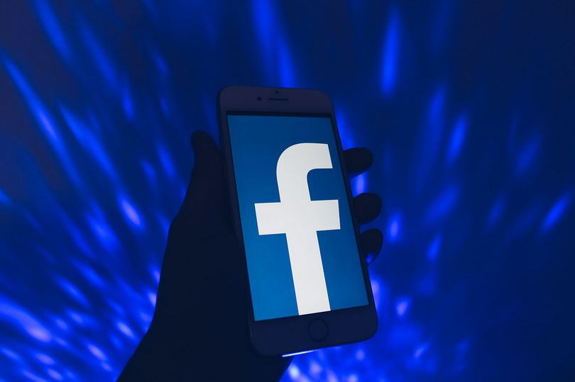Personl Holding Phone With Facebook Open