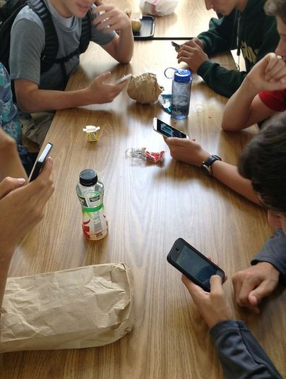 Kids At School On Cell Phones