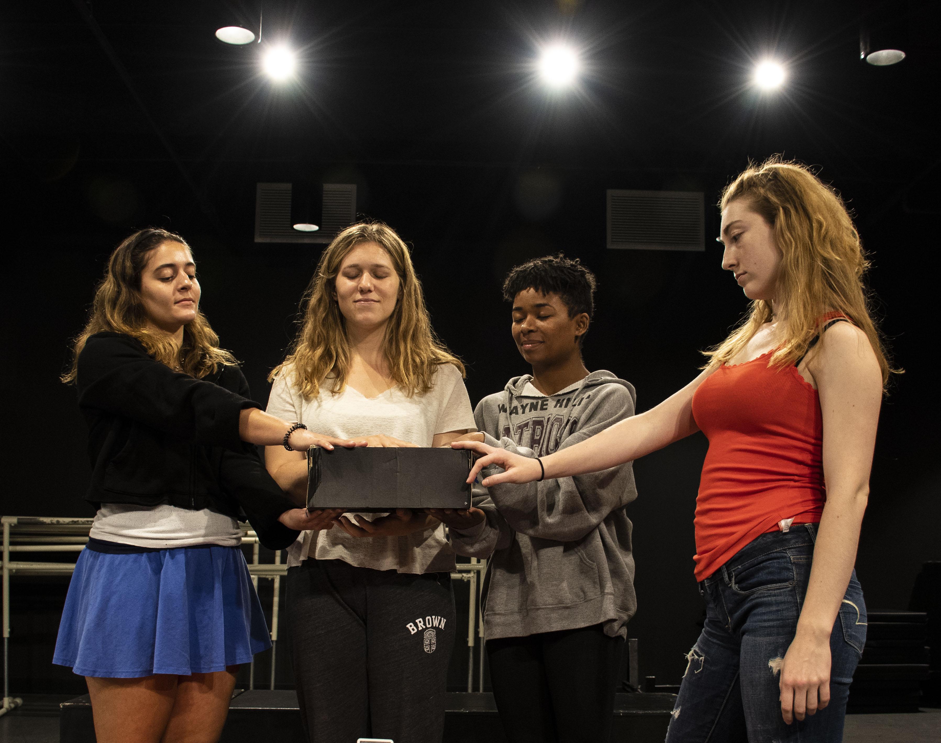 Four actresses touching the Shoebox by Shoshana
