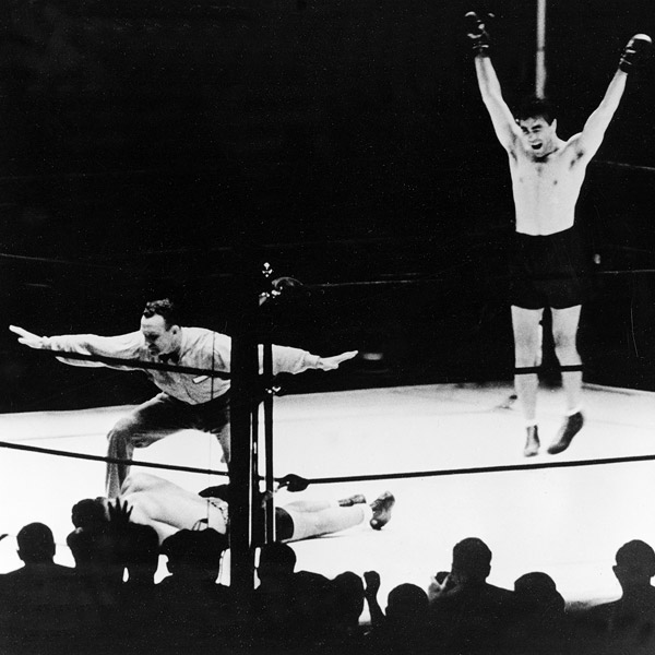 Max Schmeling knocking out Joe Louis in 1936 (Click Photot To View FIght Clip)