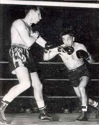 Charlie Fusari (L) decisions Joe Carkido (R) in 1950