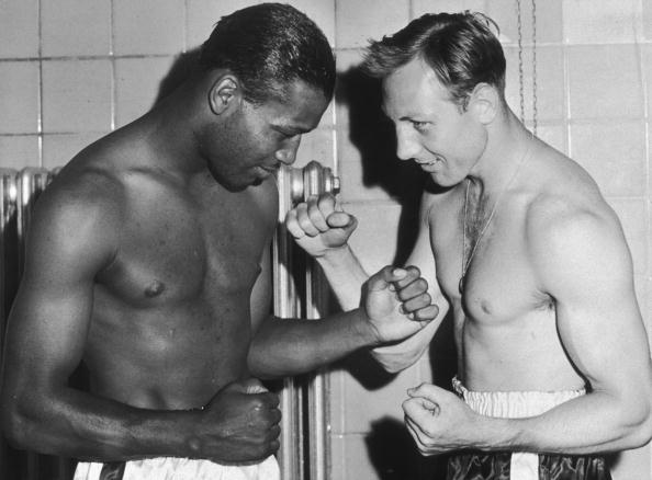 9th August 1950: Boxers Sugar Ray Robinson (1921 - 1989)(L) and Charlie Fusari assume a fighting pose after weighing in at Roosevelt Stadium, Jersey City, New Jersey. The proceeds from the fight went to charity. (Photo by New York Times Co./Getty Images)