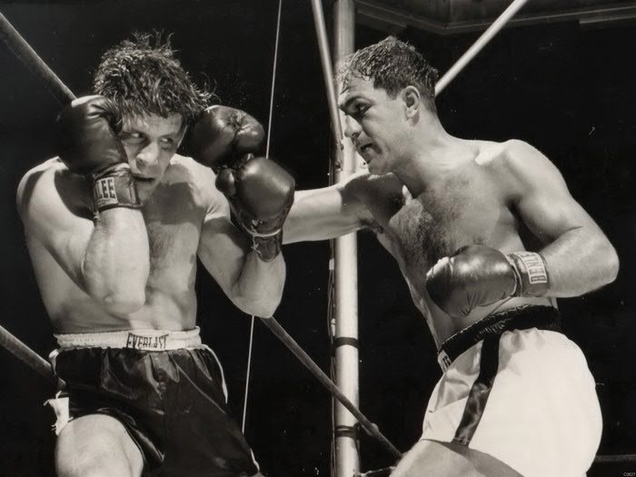 Rocky Marciano (R) attacking challenger Roland La Starza (L) in their 1953 Heavyweight Championship Battle