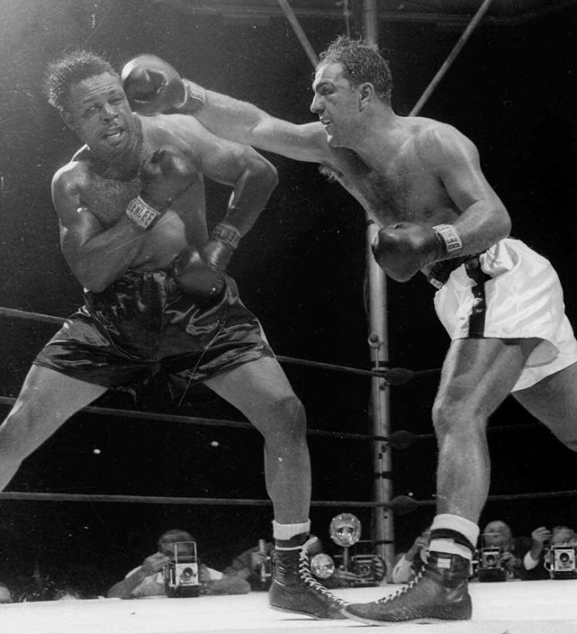 Rocky Marciano (R) smashing Archie Moore (L) with a hard right in their 1955 bout