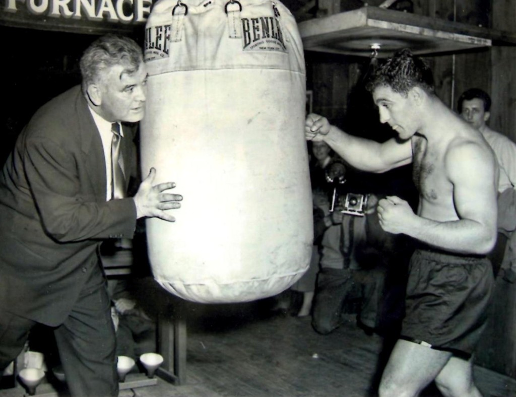 Former Heavyweight Champion James J. Braddock with heavyweight Challenger Rocky Marciano in training