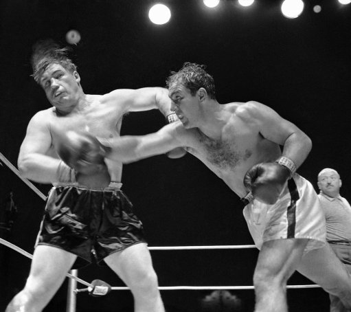 Rocky Marciano, heavyweight champion from Brockton, Mass., rocks challenger Don Cockell with a wicked right in the ninth round of their title bout at Kezar Stadium in San Francisco, Calif., May 16, 1955. Rocky kept his title via a TKO when the referee stopped the bout after 54 seconds of the ninth round. (AP Photo)