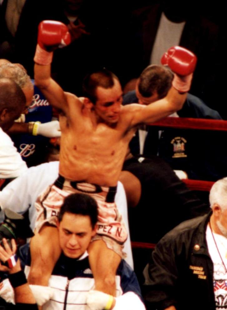 Ricardo Lopez still the IBF Light Flyweight Champion after winning his bout on September 29, 2001, in New York's Madison Square Garden,. Lopez retired after the bout with an unbelievable record of 51-0-1! (PHOTO BY ALEX RINALDI)