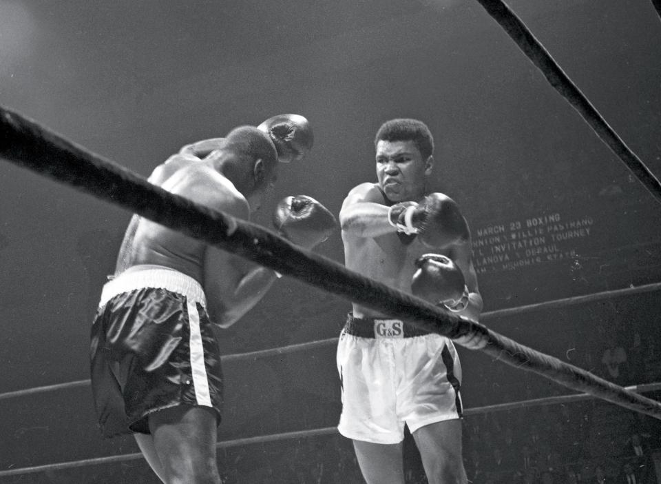 Muhammad Ali (Cassius Clay) slugs away at Doug Jones. (CLICK PHOTO TO VIEW VIDEO OF FIGHT)