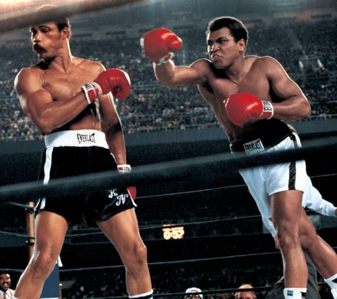Muhammad Ali throwing a right hook to Ken Norton during the WBC/ WBA World Heavyweight Title fight at Yankee Stadium. The Bronx, New York 9/28/1976 (Image # 1177 )