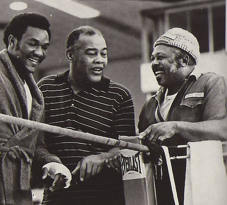 George Foreman (L) with Joe Louis (C), and Archie Moore (R).