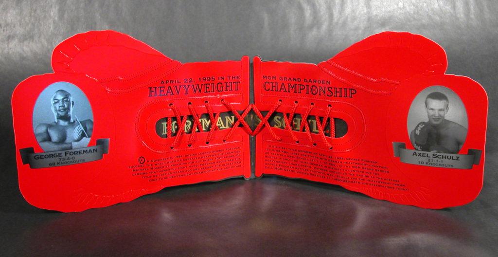 AUGUST2016George Foreman vs. Axel Schulz souvenir glove.