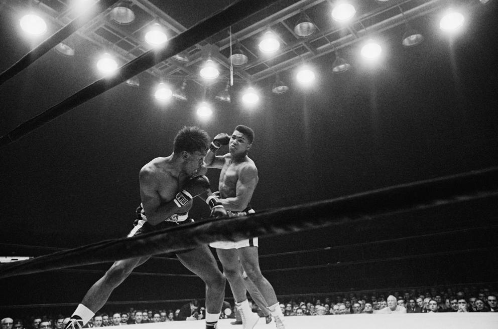 Cassius Clay gets ready to fire a right hand at Charlie Powell.