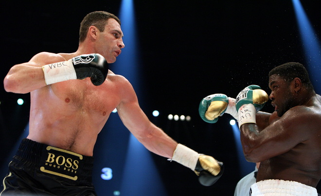 Ukrainian boxer Vitali Klitschko (L, combat name: Doctor Ironfist) exchanges punches with Nigeria's Samuel Peter (combat name: The Nigerian Nightmare) during their WBC heavyweight title fight on October 11, 2008 in Berlin. Vitali Klitschko became a world champion for the third time after beating Peter to win back the WBC heavyweight belt with a technical knock-out in the ninth round here. AFP PHOTO DDP/RONNY HARTMANN GERMANY OUT (Photo credit should read RONNY HARTMANN/AFP/Getty Images)