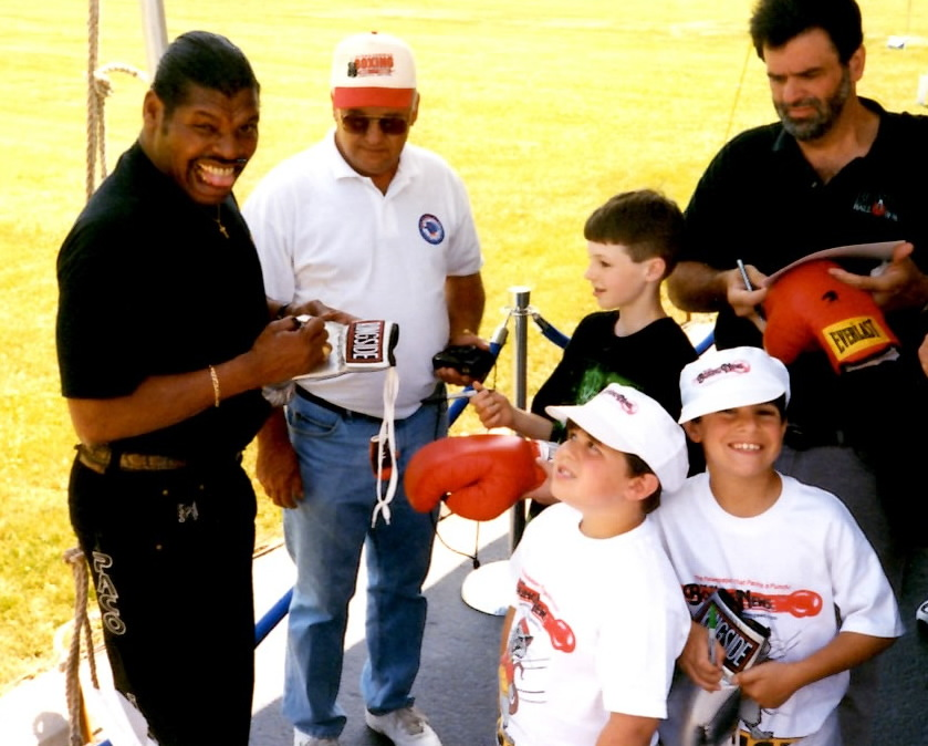 Former Heavyweight Champion and 1976 Olympic Gold Medalist Leon Spinks with Ron John and Joseph Rinaldi