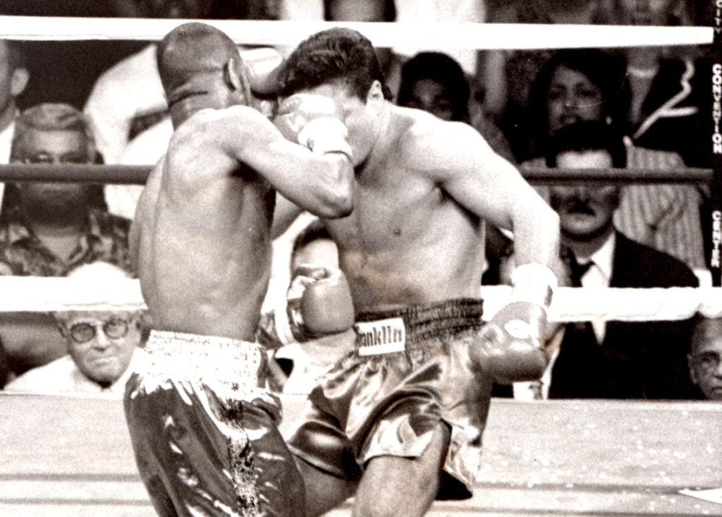 Roy Jones Jr. smashing a right into the the jaw of Vinny Pazienza