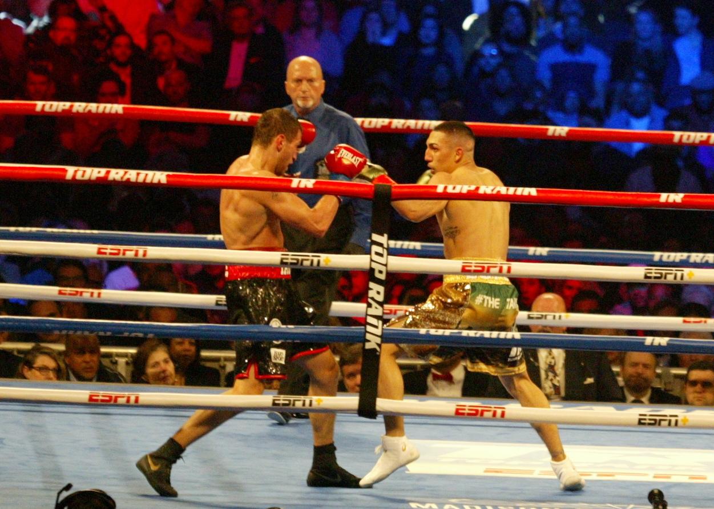 Teofimo Lopez (L) jabs at former two-time EBU European Union Lightweight king Edis Tatli (L).
