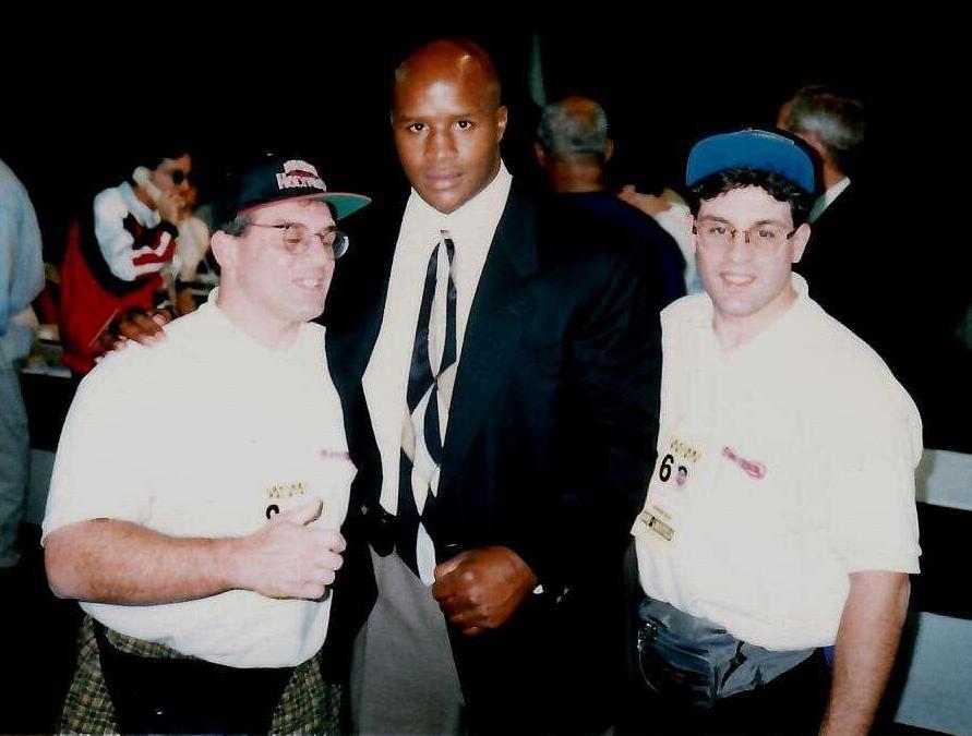 USA Boxing News Editors John Rinaldi and Alex Rinaldi with heavyweight Champion Michael Moorer in 1994.