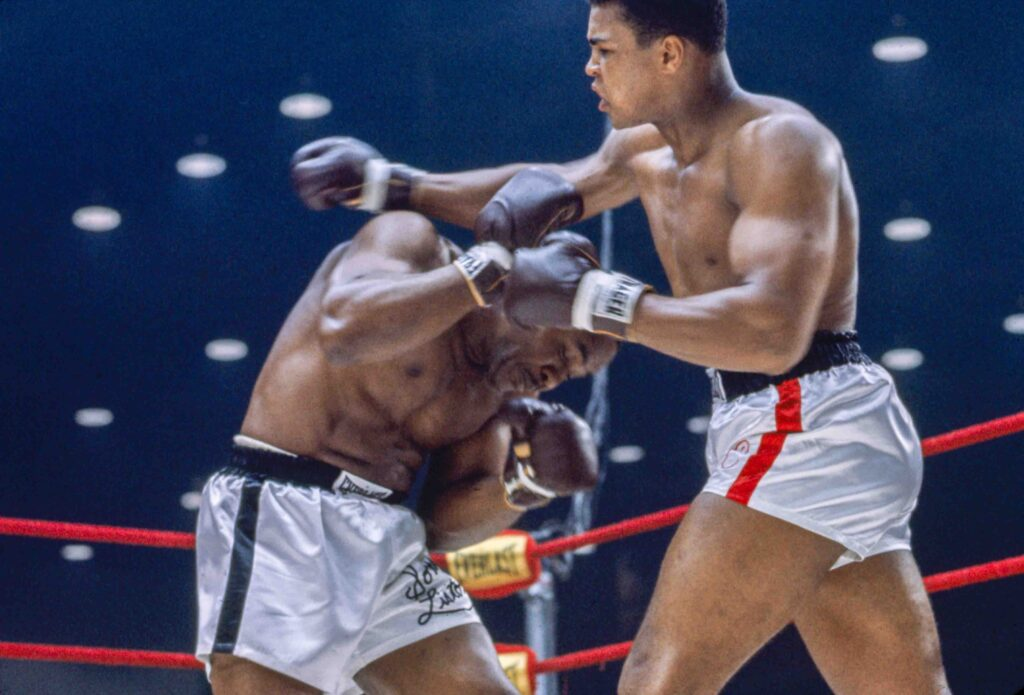 MIAMI BEACH, FL - FEBRUARY 25: Cassius Clay vs Sonny Liston at the Convention Center in Miami Beach, Florida, February 25, 1964. Cassius Clay won the World Heavyweight Title by RTD in round 6 of 15.(Photo by Stanley Weston / The Stanley Weston Archive LLC.)