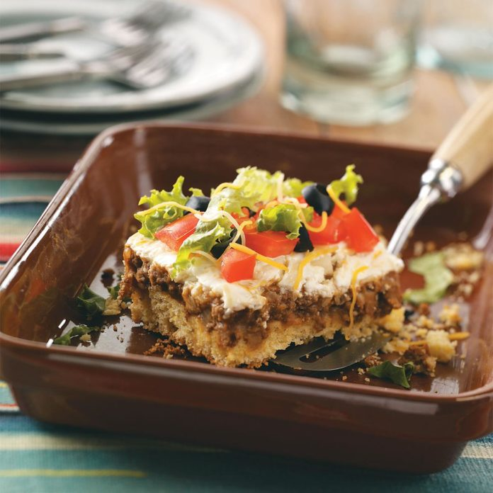 taco casserole in a brown casserole pan