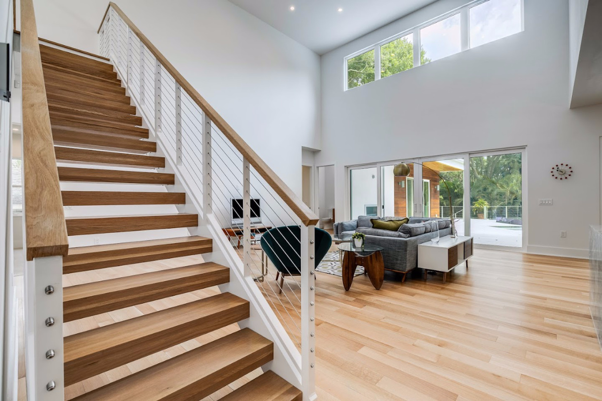 Floating-Stairs-over-Great-Room-at-2624-North-Dundee-Luxury-Homes