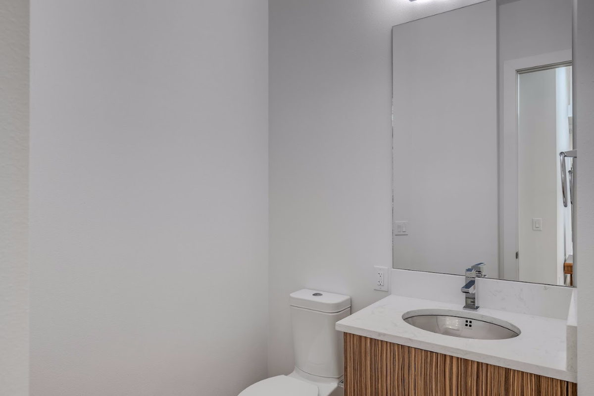 Half-Bath-with-Floating-Vantity-a-designers-choice-at-2624-N-Dundee