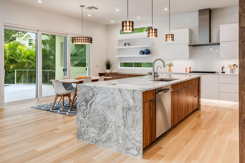 Alpha White Quartzite Kitchen Island with Waterfall Luxury Homes Tampa