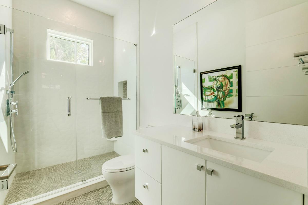 Guest Suite Bath with Framless Shower and Quartz Vanity at 438 East Davis Blvd