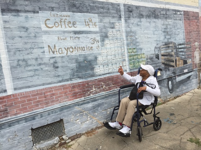 Mamie Points to Sign with Luzianne coffee