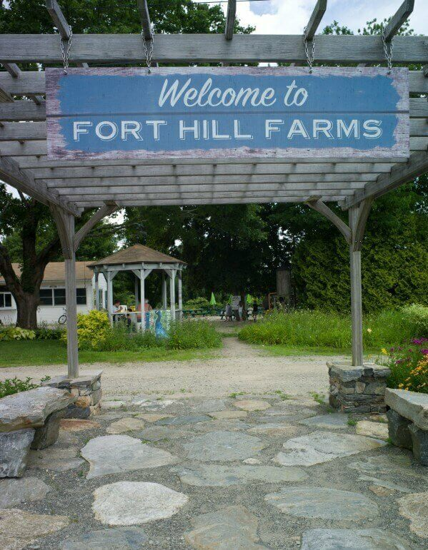 Welcome to Fort Hill Farms entrance sign