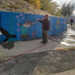 Volunteers at Commitment to Communtiy's mural cleanup