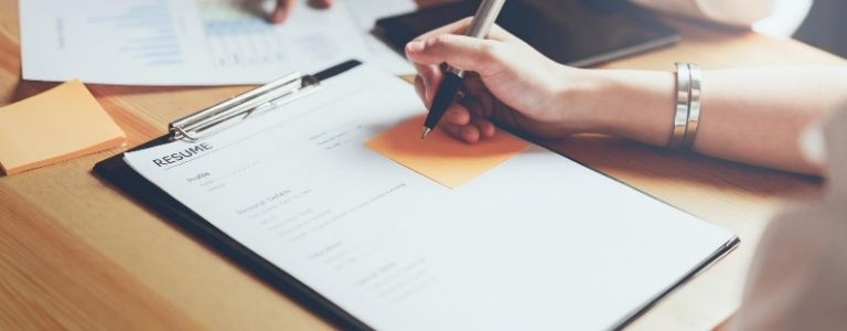 woman filling out resume criminal law fargo