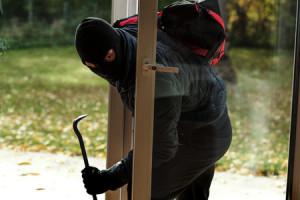25745958 - burglar entering to house through the window