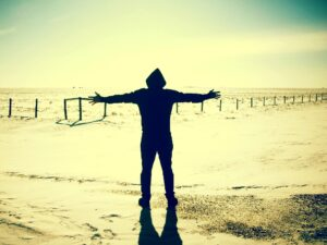 silhouette of person with outstretched arms