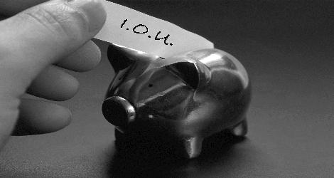 photo of piggy bank and i.o.u. note