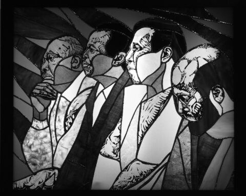 Stained glass portrait of Taxi Workers' Alliance Group