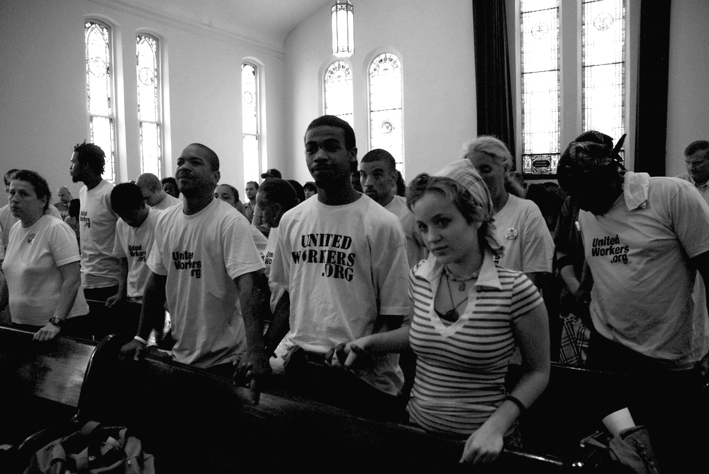photo of strikers and allies in church praying for workers